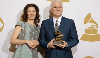 "FILE - This Jan. 26, 2014 file photo shows Edie Brickell, left, and Steve Martin in the press room with the award for best American roots song, ""Love Has Come For You,"" at the 56th annual Grammy Awards at Staples Center in Los Angeles. ""Great Performances"" concert with Steep Canyon Rangers is set to air on PBS and they will soon start a tour that wraps with three concerts at The Hollywood Bowl in Los Angeles over the Fourth of July weekend. (Photo by Dan Steinberg/Invision/AP, File)"