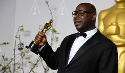 """Director Steve McQueen poses in the press room with the award for best picture for """"12 Years a Slave"""" during the Oscars at the Dolby Theatre on Sunday, March 2, 2014, in Los Angeles.  (Photo by Jordan Strauss/Invision/AP)"""
