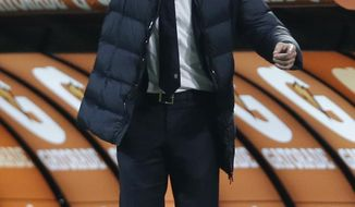 Juventus coach Antonio Conte points to his players during a Serie A soccer match between AC Milan and Juventus, at the San Siro stadium in Milan, Italy, Sunday, March 2, 2014. (AP Photo/Luca Bruno)