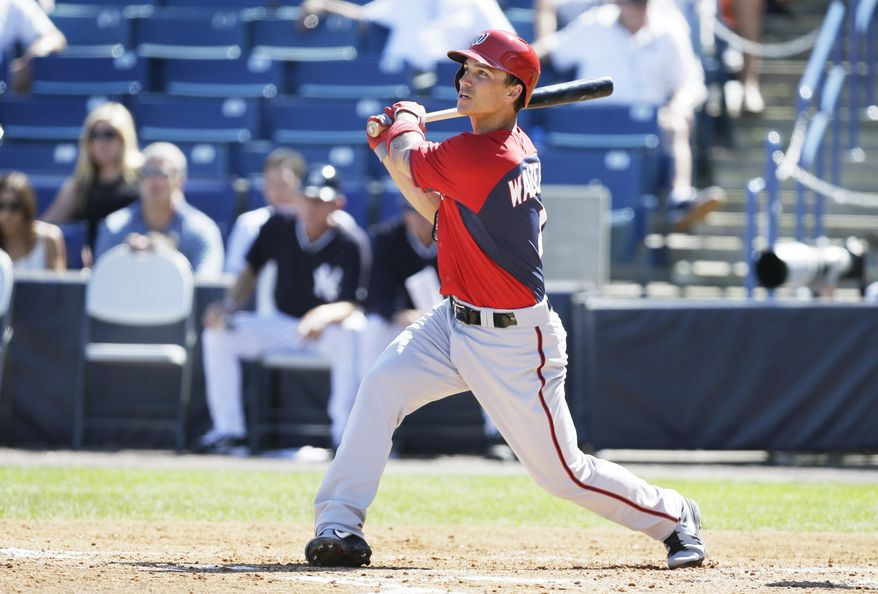 Washington Nationals shortstop Zach Walters watches his home run during the fifth inning of an exhibition baseball game against the New York Yankees Monday, March 3, 2014, in Tampa, Fla. (AP Photo/Charlie Neibergall)