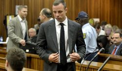Oscar Pistorius inside the high court in Pretoria, South Africa, Monday, March 3, 2014. Pistorius is charged with murder with premeditation in the shooting death of girlfriend Reeva Steenkamp in the pre-dawn hours of Valentine's Day 2013. (AP Photo/Herman Verwey, Pool)