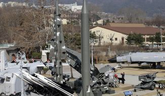 A mock Scud-B missile of North Korea, center, and other South Korean missiles are displayed at the Korea War Memorial Museum in Seoul, South Korea, Monday, March 3, 2014. North Korea fired two additional suspected short-range missiles into the sea Monday amid ongoing military exercises between Seoul and Washington, which the North calls a preparation for an attack, South Korean officials said. (AP Photo/Lee Jin-man)