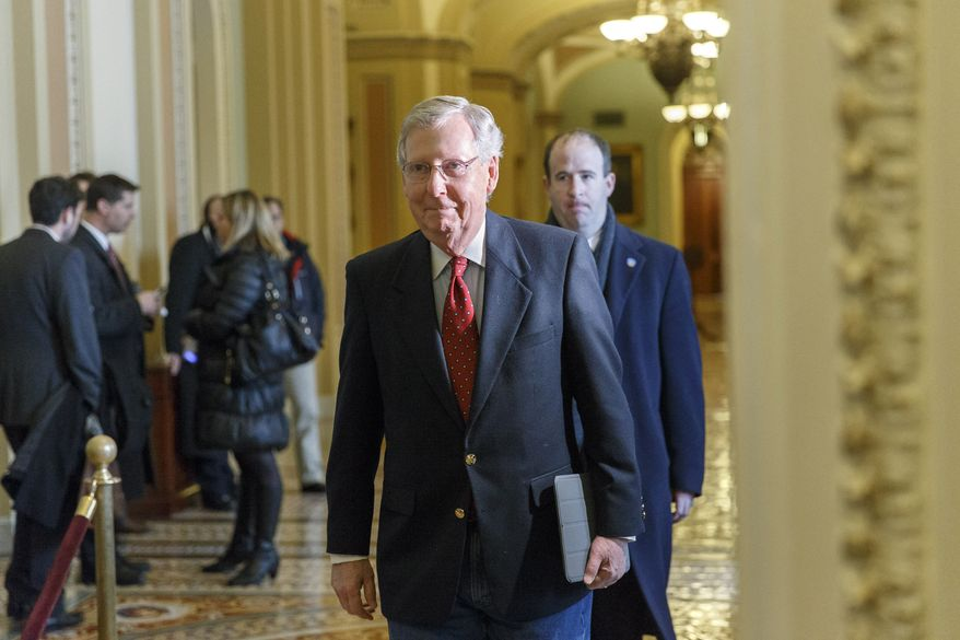 Senate Minority Leader Mitch McConnell, R-Ky., walks to a meeting with Israeli Prime Minister Benjamin Netanyahu at the Capitol in Washington, Monday, March 3, 2014. The U.S. is currently brokering peace talks between Israelis and Palestinians while trying to manage Israel's suspicions about President Obama's pursuit of a nuclear accord with Iran.  (AP Photo/J. Scott Applewhite)