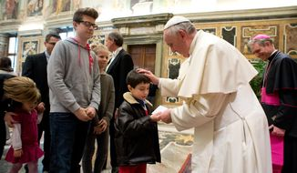 In this picture provided by the Vatican newspaper L'Osservatore Romano, Pope Francis meets families of the participants in the assembly of Italian Federation for the Spiritual Exercises  at the Vatican, Monday, March 3, 2014. (AP Photo/L'Osservatore Romano, ho)