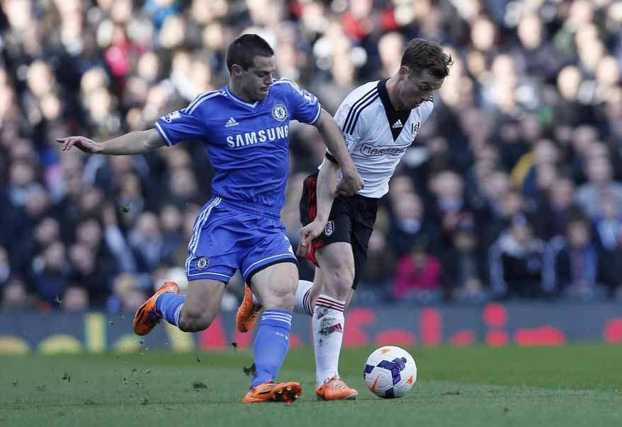 Fulham's Scott Parker, right, competes with Chelsea's Cesar Azpilicueta during their English Premier League soccer match at Craven Cottage, London, Saturday, March 1, 2014. (AP Photo/Sang Tan)