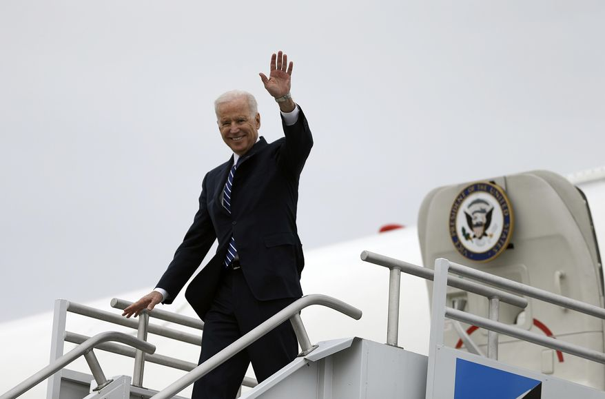 Vice President Joe Biden arrives at Hartsfield-Jackson Atlanta International airport, Tuesday, March 4, 2014, in Atlanta. The White House said in a brief statement that the vice president will attend an event for U.S. Senate candidate Michelle Nunn at a private residence at 1 p.m. Tuesday. (AP Photo/David Goldman, Pool)