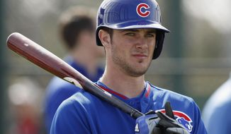 FILE - In this Feb. 21, 2014 file photo, Chicago Cubs third baseman Kris Bryant prepares to take batting practice during spring training baseball practice in Mesa, Ariz. Bryant, 22, is a big-time prospect.  (AP Photo/Rick Scuteri, File)