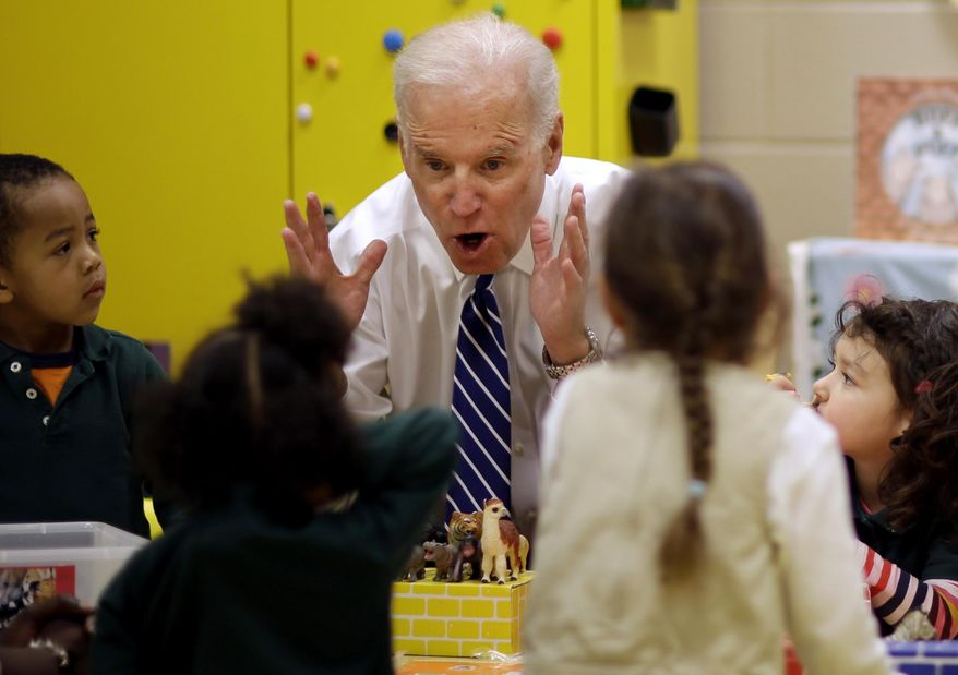 Vice President Joe Biden talks with children in a classroom while visiting the East Lake Family YMCA, Tuesday, March 4, 2014, in Atlanta. Biden is campaigning and raising money around the country for Democrats in the 2014 midterm elections. Many of his stops are in states, like Georgia, where President Barack Obama is unpopular among white voters. (AP Photo/David Goldman)