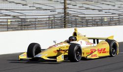 FILE - In this May 9, 2013 file photo, NASCAR driver Kurt Busch drives down the front straightaway in an Andretti Autosport Indycar during a testing session at the Indianapolis Motor Speedway in Indianapolis. Kurt Busch and Andretti Autosport announced Tuesday, March 4, 2014, that he will try to become the first driver in 10 years to run the Indianapolis 500 and the Coca-Cola 600 on the same day.  (AP Photo/AJ Mast, File)