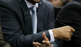 Denver Nuggets head coach Brian Shaw directs players during the first quarter of an NBA basketball game against the Minnesota Timberwolves Monday, March 3, 2014, in Denver. (AP Photo/Barry Gutierrez)