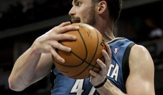 Minnesota Timberwolves' Kevin Love (42) grabs a rebound against the Denver Nuggets during the first quarter of an NBA basketball game Monday, March 3, 2014, in Denver. (AP Photo/Barry Gutierrez)