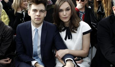 Actress Keira Knightley and her husband James Righton pose as they attend Chanel's ready to wear fall/winter 2014-2015 fashion collection presented in Paris, Tuesday, March 4, 2014. (AP Photo/Thibault Camus)