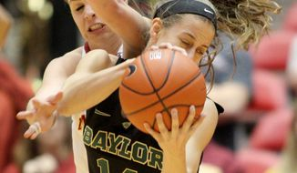 Iowa State forward Hallie Christofferson fouls Baylor guard Makenzie Robertson as they vie for a rebound during the first half of an NCAA college basketball game in Ames, Iowa, Tuesday, March 4, 2014. (AP Photo/Justin Hayworth)