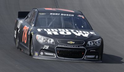 FILE - In this Aug. 18, 2013, file photo, Kurt Busch races during the NASCAR Sprint Cup series Pure Michigan 400 auto race at Michigan International Speedway in Brooklyn, Mich. Kurt Busch and Andretti Autosport announced Tuesday, March 4, 2014, that he will try to become the first driver in 10 years to run the Indianapolis 500 and the Coca-Cola 600 on the same day. (AP Photo/Paul Sancya, File)