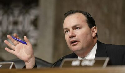 **FILE** Senate Armed Services Committee member Sen. Mike Lee, R-Utah, questions former Nebraska Republican Sen. Chuck Hagel, President Obama's choice to lead the Pentagon, during his confirmation hearing before the committee on Capitol Hill in Washington, Thursday, Jan. 31, 2013.  (AP Photo/J. Scott Applewhite)