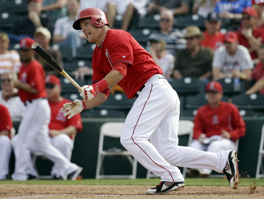 Los Angeles Angels' Mike Trout hits a single during the sixth inning of an exhibition spring training baseball game against the Texas Rangers Tuesday, March 4, 2014, in Tempe, Ariz. (AP Photo/Morry Gash)