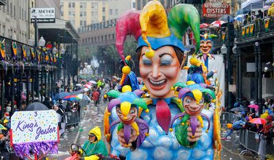 The King's Jester float makes its way toward the Canal Street turn on during a Mardi Gras parade, Tuesday, March 4, 2014, in New Orleans. (AP Photo/NOLA.com The Times-Picayune, David Grunfeld) MAGS OUT; NO SALES; USA TODAY OUT; THE BATON ROUGE ADVOCATE OUT