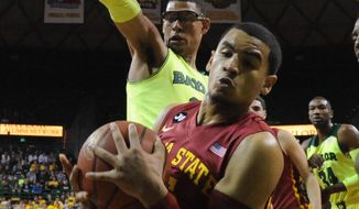 Iowa State guard Naz Long (15) pulls down a rebound in front of Baylor center Isaiah Austin during the first half of an NCAA college basketball game, Tuesday, March 4, 2014, in Waco, Texas. Baylor won 74-61. (AP Photo/Waco Tribune Herald, Katherine Hooker)