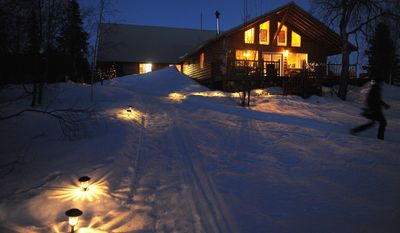 In this March 2, 2014 photo, the Winterlake lodge is lit at the Finger Lake checkpoint of the 2014 Iditarod Trail Sled Dog Race, Sunday evening near Wasilla, Alaska. (AP Photo/Anchorage Daily News, Bob Hallinen) LOCAL TV OUT (KTUU-TV, KTVA-TV) LOCAL PRINT OUT (THE ACHORAGE PRESS, THE ALASKA DISPATCH)