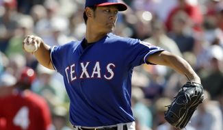 Texas Rangers' Yu Darvish throws before the second inning of an exhibition spring training baseball game against the Los Angeles Angels Tuesday, March 4, 2014, in Tempe, Ariz. (AP Photo/Morry Gash)