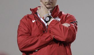 Ohio State head coach Urban Meyer watches his team during NCAA college football practice Tuesday, March 4, 2014, in Columbus, Ohio. (AP Photo/Jay LaPrete)
