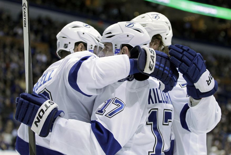 Tampa Bay Lightning's Alex Killorn (17) is congratulated by teammates after scoring a goal during the first period of an NHL hockey game against the St. Louis Blues, Tuesday, March 4, 2014 in St. Louis.(AP Photo/Tom Gannam)