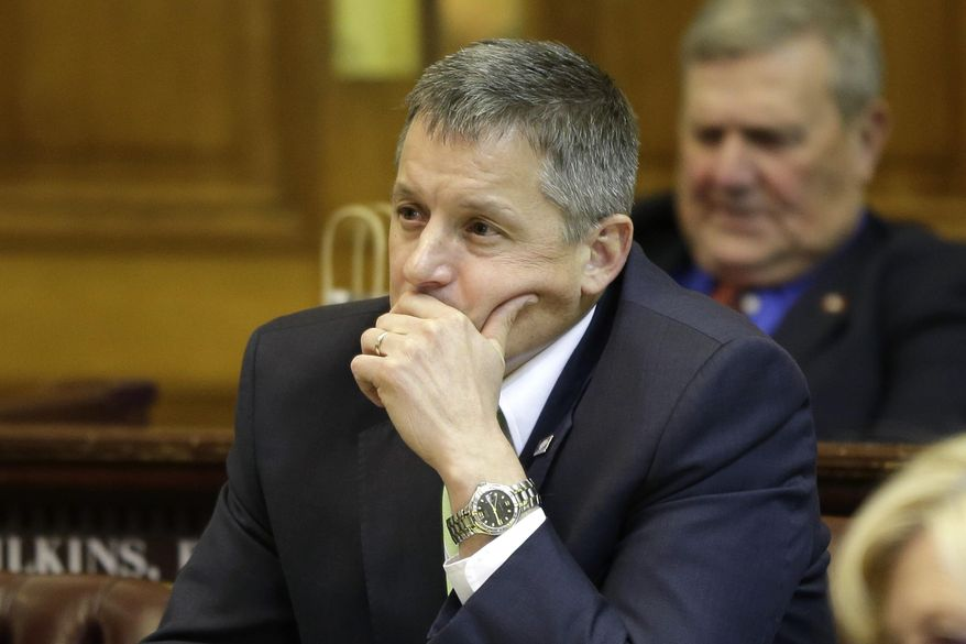 Rep. Bruce Westerman, R-Hot Springs, listens to discussion of Arkansas' plan that uses Medicaid funds to buy private insurance for the poor on the House floor at the Arkansas state Capitol in Little Rock, Ark., Tuesday, March 4, 2014. The measure, opposed by Westerman, passed in the House Tuesday. (AP Photo/Danny Johnston)