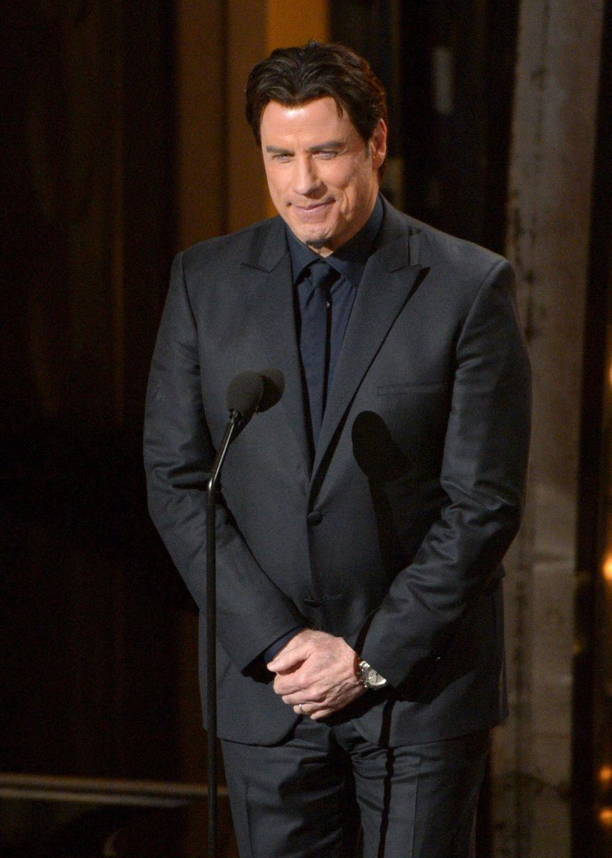 Presenter John Travolta speaks during the Oscars at the Dolby Theatre on Sunday, March 2, 2014, in Los Angeles.  (Photo by John Shearer/Invision/AP)