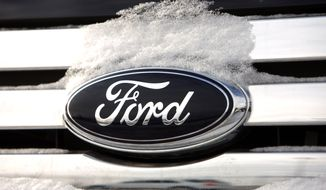 FILE - In this Sunday, Jan. 4, 2009, file photo, snow builds up on the company logo on the chromed grille of a vehicle at a Ford dealership in Denver. The federal government said Tuesday, March 4, 2014, it is closing an investigation into 1.6 million Ford vehicles that can lose engine power after Ford agreed to a remedy.  (AP Photo/David Zalubowski, File)