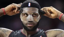 Miami Heat forward LeBron James (6) enters the game during the second quarter of an NBA basketball game against the Houston Rockets, Tuesday, March, 4, 2014, in Houston. (AP Photo/Patric Schneider)
