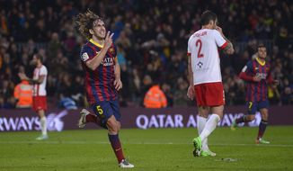 FC Barcelona's Carles Puyol reacts after scoring against Almeria during a Spanish La Liga soccer match at the Camp Nou stadium in Barcelona, Spain, Sunday, March 2, 2014. (AP Photo/Manu Fernandez)
