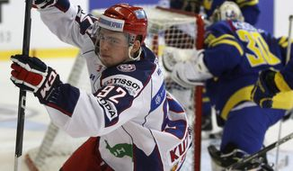 Russia's Evgeny Kuznetsov celebrates after scoring against Sweden during the Czech Hockey Games ice hockey match in Brno, Czech Republic, Saturday, April 28, 2012. (AP Photo/Petr David Josek)