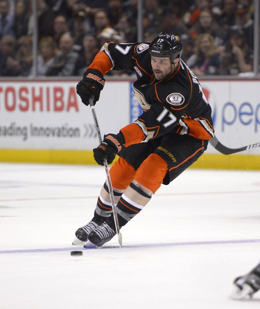 Anaheim Ducks left wing Dustin Penner passes the puck during the second period of an NHL hockey game against the Calgary Flames, Friday, Nov. 29, 2013, in Anaheim, Calif. (AP Photo/Mark J. Terrill)