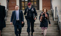 Brig. Gen. Jeffrey Sinclair leaves the courthouse with his lawyers Richard Scheff, left, and Ellen C. Brotman, following a day of motions Tuesday, March 4, 2014, at Fort Bragg, N.C. Less than a month before Sinclair's trial on sexual assault charges, the lead prosecutor broke down in tears Tuesday as he told a superior he believed the primary accuser in the case had lied under oath. (AP Photo/The Fayetteville Observer, James Robinson)