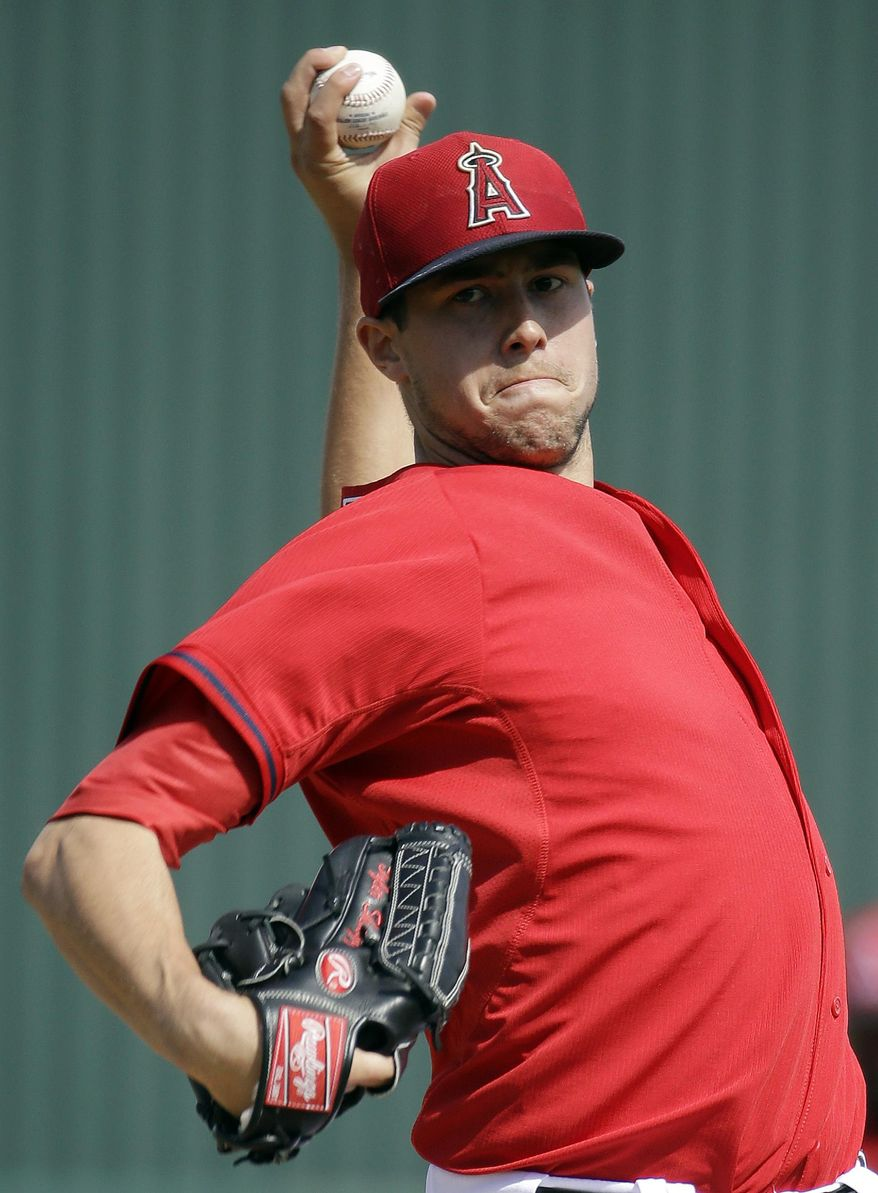 Los Angeles Angels' Tyler Skaggs throws during the first inning of an exhibition spring training baseball game against the Texas Rangers Tuesday, March 4, 2014, in Tempe, Ariz. (AP Photo/Morry Gash)