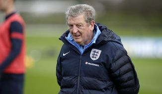 England manager Roy Hodgson supervises a national soccer squad training session at the training facilities of Tottenham Hotspur football club in Enfield, England, Monday, March 3, 2014. England play Denmark in an international friendly soccer match at Wembley stadium in London on Wednesday. (AP Photo/Matt Dunham)