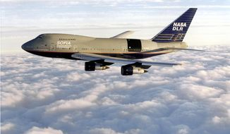 In this 1998 photo provided by NASA and Universities Space Research Association (USRA) shows a modified Boeing 747SP jetliner containing the Stratospheric Observatory for Infrared Astronomy (SOFIA) infrared observatory, a project of NASA and the German Aerospace Center. The White House released its budget on Tuesday, March 4, 2014, that proposes to mothball the observatory unless Germany and other partners can kick in more money. (AP Photo/NASA/USRA)