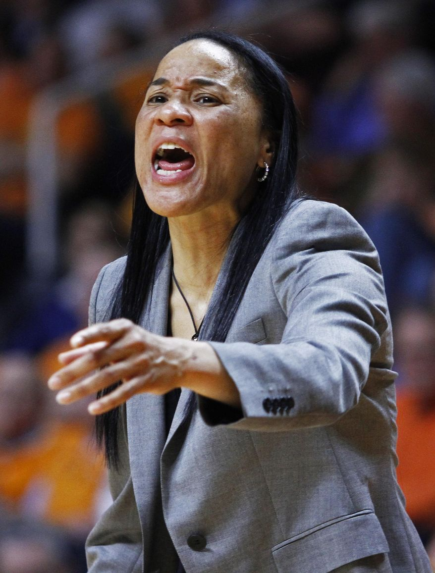 South Carolina coach Dawn Staley yells to her team in the second half of an NCAA college basketball game against Tennessee on Sunday, March 2, 2014, in Knoxville, Tenn. Tennessee won 73-61. (AP Photo/Wade Payne)