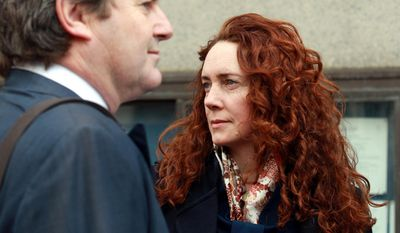 Former News International chief executive Rebekah Brooks and her husband Charlie Brooks arrive at the Old Bailey, the Central Criminal Court, in London, Monday March 3rd,  2014. for the continuation of the phone hacking trial. (AP Photo/PA, Sean Dempsey)  UNITED KINGDOM OUT  NO SALES  NO ARCHIVE