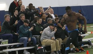 Pro scouts time Auburn's Dee Ford in the 40-yard dash at pro day for NFL football teams, Tuesday, March 4, 2014, in Auburn, Ala. (AP Photo/Hal Yeager)