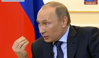 In this frame grab provided by the Russian Television via the APTN,  President Vladimir Putin, during a live feed, answers journalists' questions on the current situation around Ukraine at the Novo-Ogaryovo presidential residence outside Moscow, on Tuesday, March 4, 2014. (AP Photo/Russian Television via APTN)