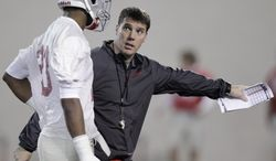 Ohio State's new co-defensive coordinator and safeties coach Chris Ash instructs defensive back Tyvis Powell during their Spring NCAA college football practice Tuesday, March 4, 2014, in Columbus, Ohio. (AP Photo/Jay LaPrete)