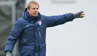 Juergen Klinsmann, coach of the US American national soccer team, leads a training session of his team  in Frankfurt Germany, Monday March 3, 2014. The US team will face Ukraine on Cyprus on Wednesday.   (AP Photo/dpa,Boris Roessler)