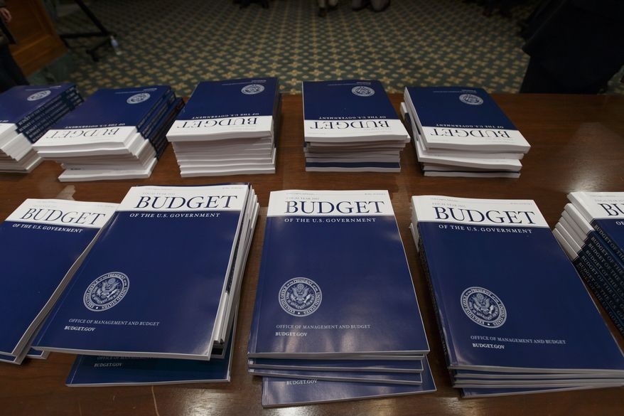 Copies of President Barack Obama's proposed fiscal 2015 budget are set out for distribution by the Senate Budget Committee on Capitol Hill in Washington, Tuesday, March 4, 2014. President Obama is unwrapping a nearly $4 trillion budget that gives Democrats an election-year playbook for fortifying the economy and bolstering Americans' incomes. It also underscores how pressure has faded to launch bold, new attacks on federal deficits. (Associated Press)