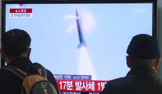 People watch TV reporting North Korea's missile test at Seoul Railway Station in Seoul, South Korea, Tuesday, March 4, 2014.  South Korea says North Korea has fired seven suspected artillery shells into the seas following its recent series of Scud missile launches. (AP Photo/Ahn Young-joon)