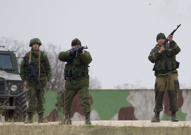 Russian soldiers fire warning shots at the Belbek air base, outside Sevastopol, Ukraine, on Tuesday, March 4, 2014. Russian troops, who had taken control over Belbek airbase, fired warning shots in the air as around 300 Ukrainian officers marched towards them to demand their jobs back. (AP Photo/Ivan Sekretarev)