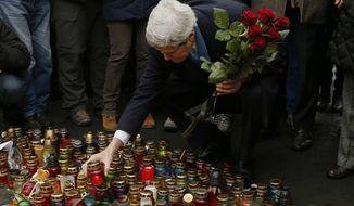 Associated Press Secretary of State John F. Kerry remembers Ukrainian protesters at the Shrine of the Fallen in Kiev. Over the course of the Maidan demonstrations, almost 100 were killed by police.