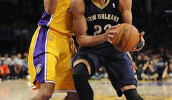New Orleans Pelicans forward Anthony Davis (23) works against Los Angeles Lakers forward Wesley Johnson, left, during the first half of an NBA basketball game, Tuesday, March 4, 2014, in Los Angeles.(AP Photo/Gus Ruelas)