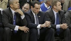 Duke head coach Mike Krzyzewski, center, and assistant coaches Jeff Capel, left, and Steve Wojciechowski, right, watch the final minute of an NCAA college basketball game against Wake Forest in Winston-Salem, N.C., Wednesday, March 5, 2014. Wake Forest won 82-72. (AP Photo/Chuck Burton)