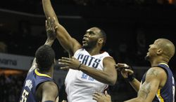Charlotte Bobcats center Al Jefferson, center, shoots over Indiana Pacers center Roy Hibbert during the first half of an NBA basketball game in Charlotte, N.C., Wednesday, March 5, 2014. (AP Photo/Nell Redmond) ,